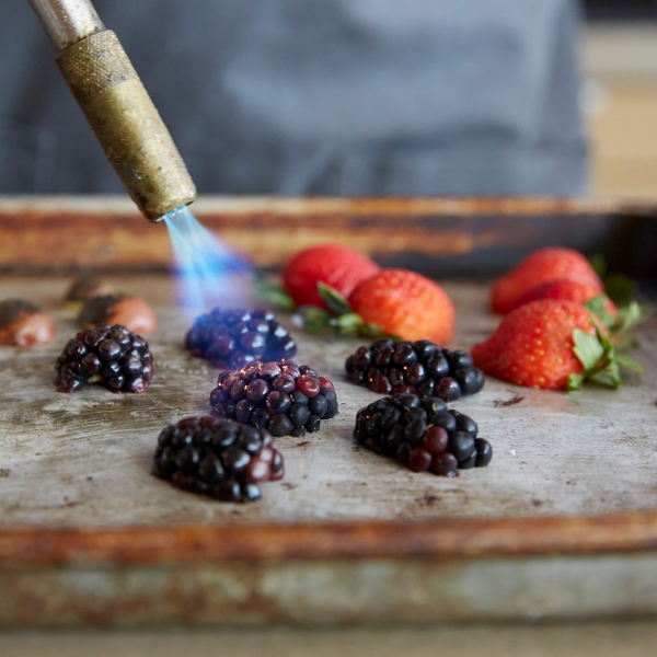 Close up of flambé blackberries and strawberries at Miraval.