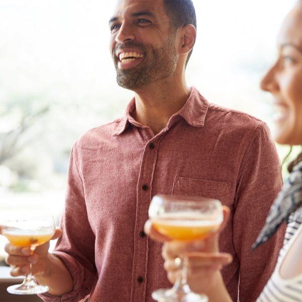 Man and woman enjoy drinks outdoors at Miraval.