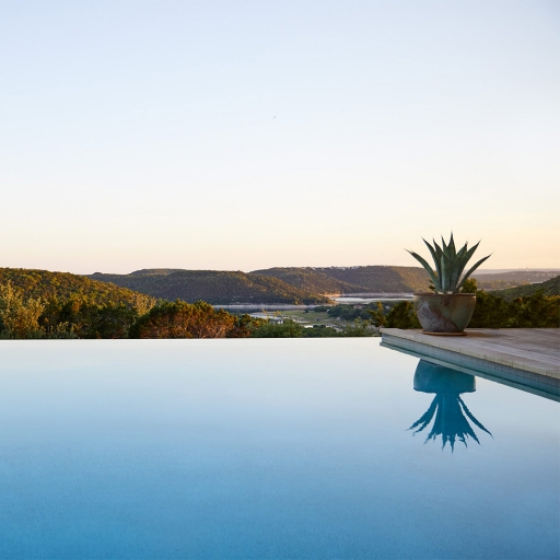 View from the infinity pool at sunset at Miraval Austin.