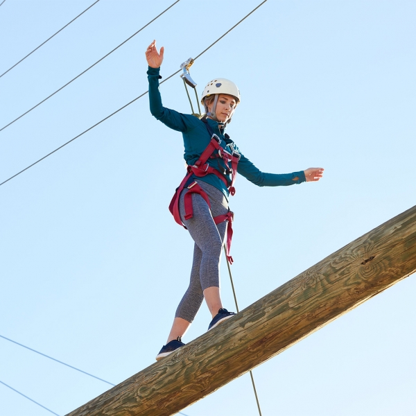 Woman walks on elevated challenge course at Miraval.