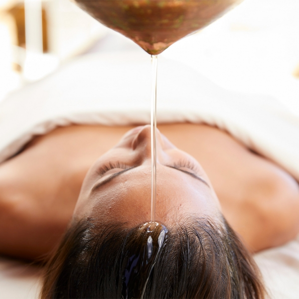 Woman enjoys spa service at Miraval Resort.